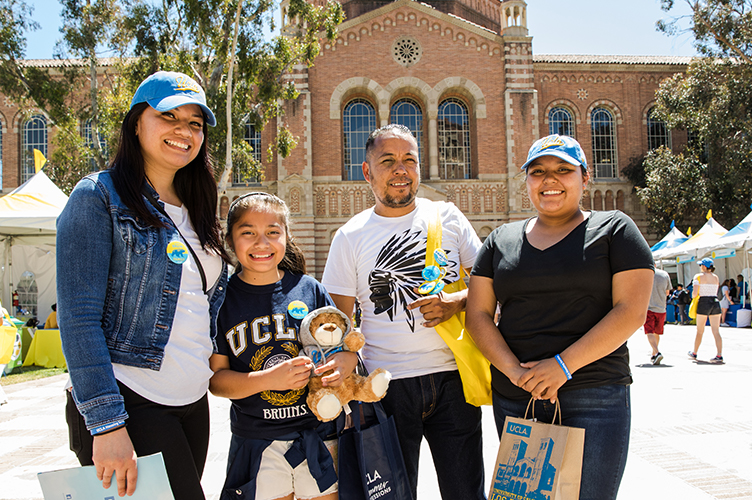 Family standing in front of Powell Library on Bruin Day