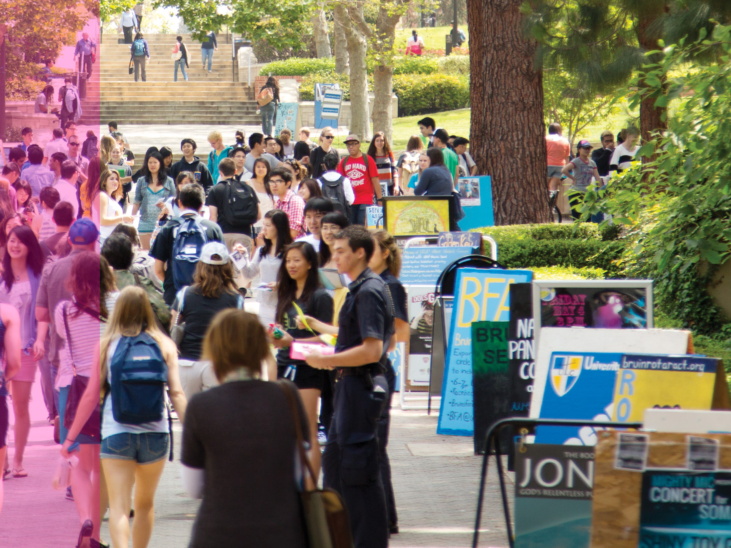 Students make their way down Bruin Walk, passing posters for student clubs and organizations.