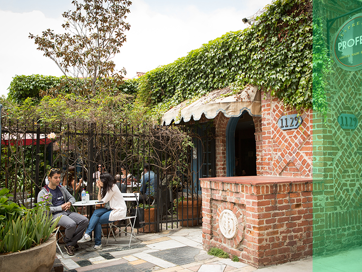 Students talk and relax over on the charming patio of a coffee shop in Westwood.