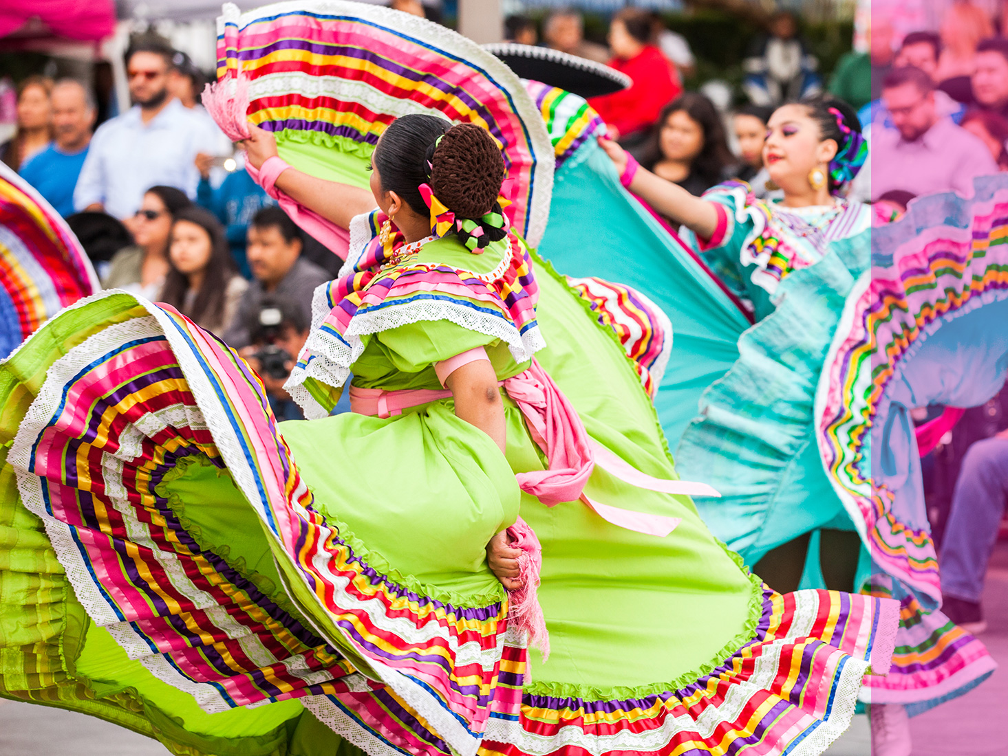 Colorfully dressed flamenco dancers perform before a crowd in downtown L.A.