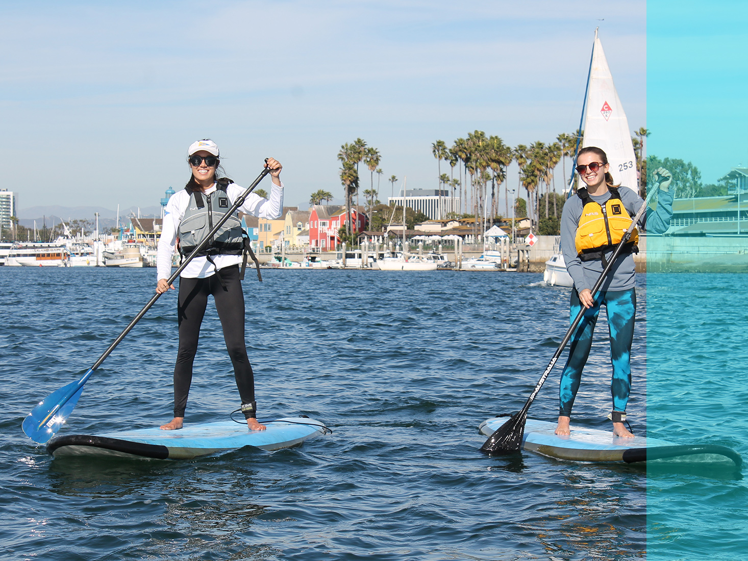 Two students work on their paddle boarding skills at the Marina.