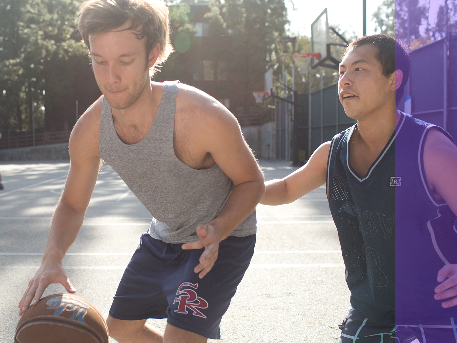 A couple of Bruins play basketball at the Sunset Recreation courts.