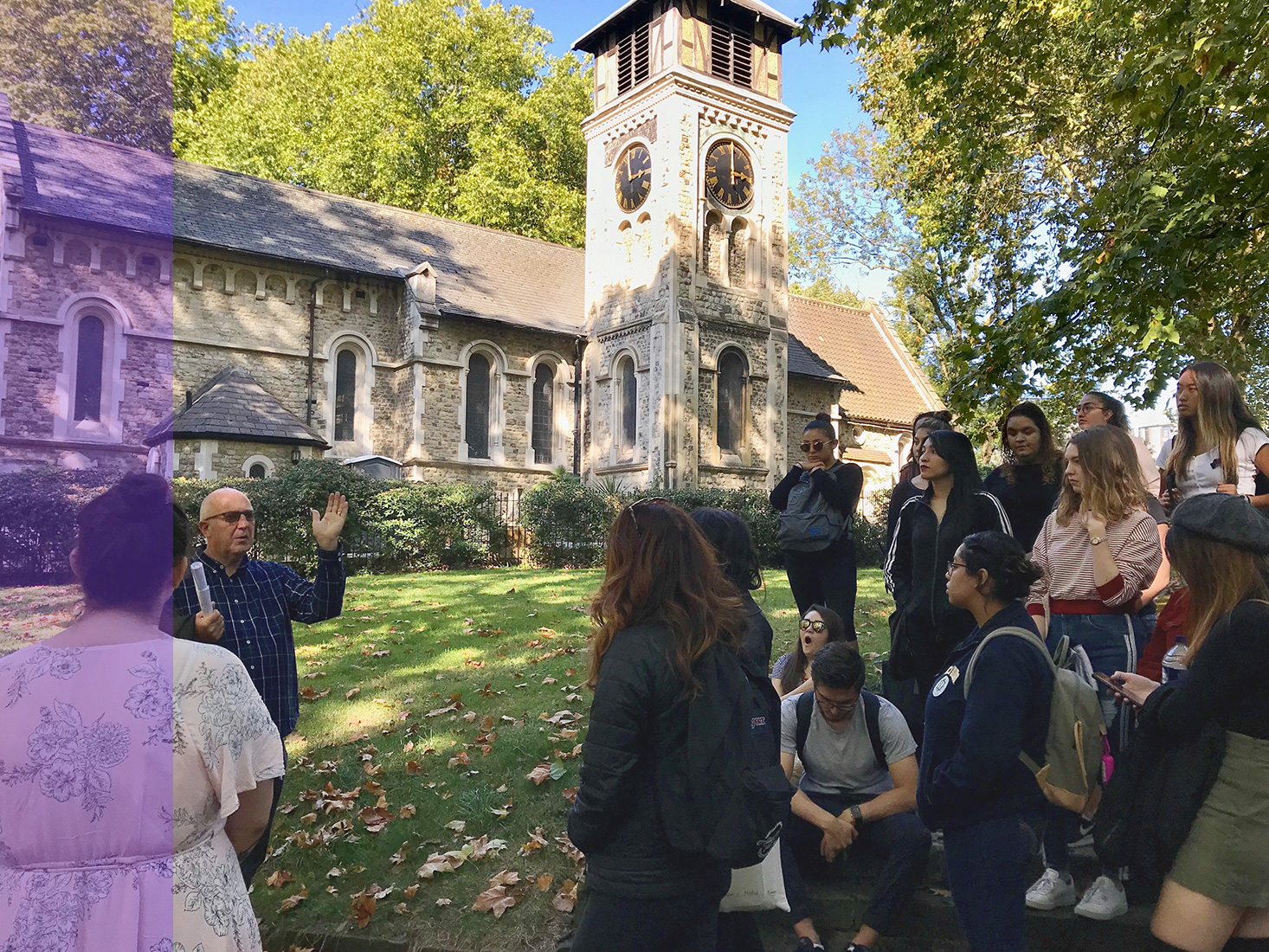 A group of students in England learn about the historic location they're visiting.