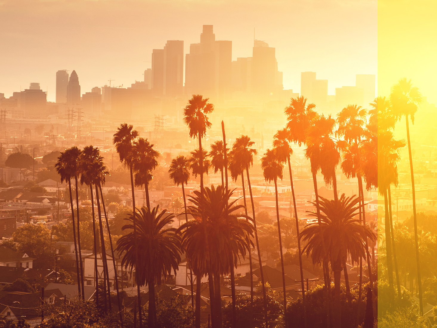 The setting sun creates a warm glow over Los Angeles.