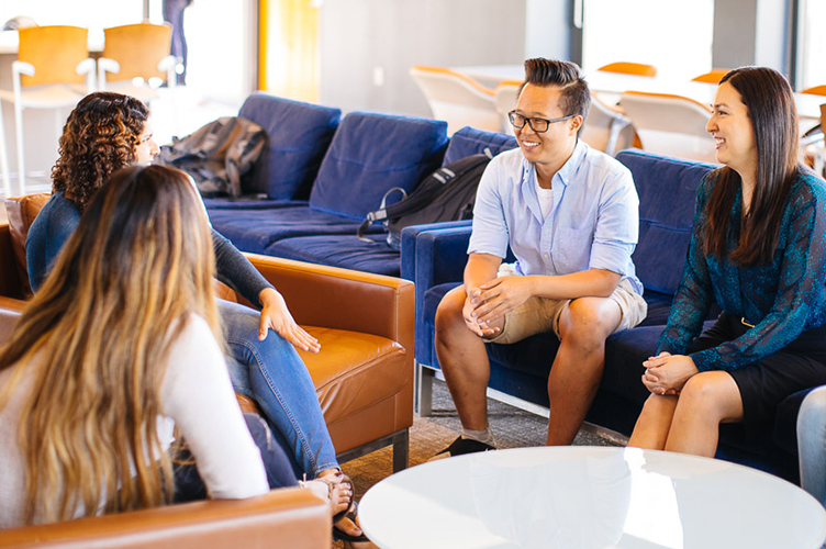 Students talk in a lounge.