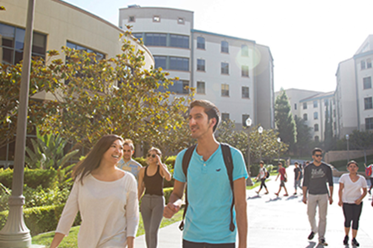 Students walk across campus near the Hill.