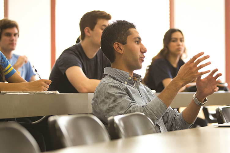 A student voices his opinion in a small interdisciplinary course.