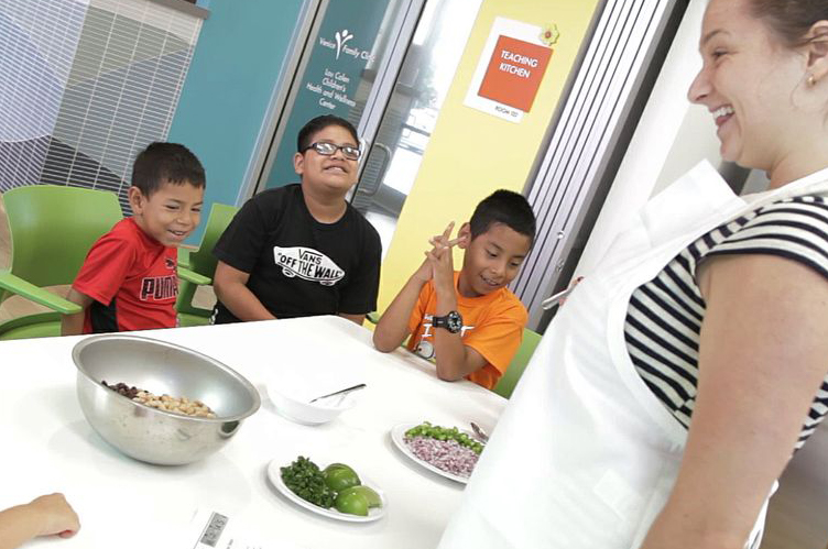 A student teaches kids about healthy eating.