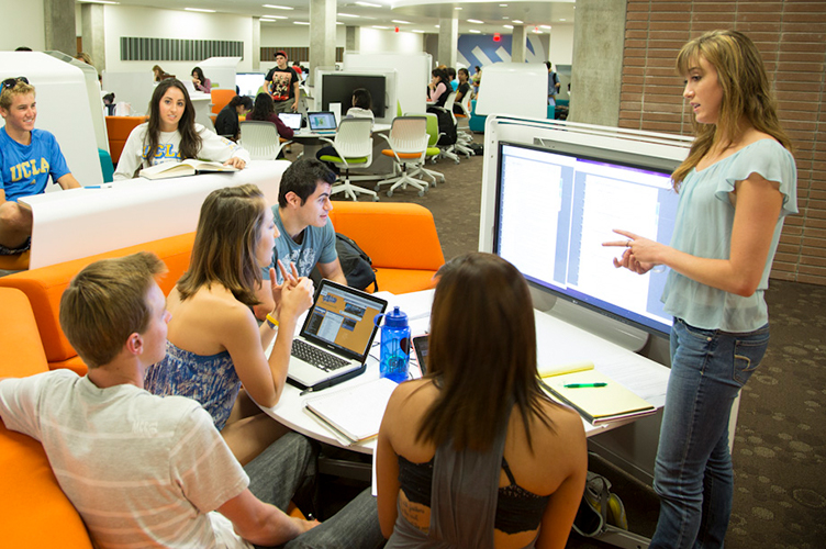 An instructor talks to a group of students in Charles E. Young Research Library.