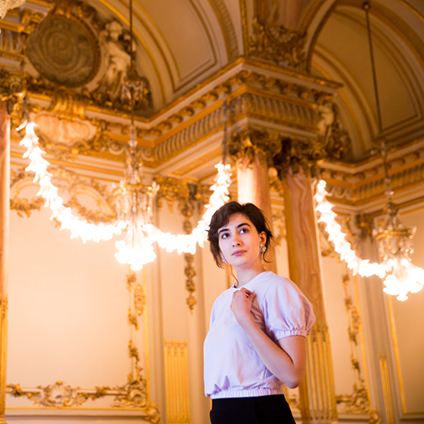 Sarah Brandenburg poses in a historic ballroom inside the Musée d'Orsay.
