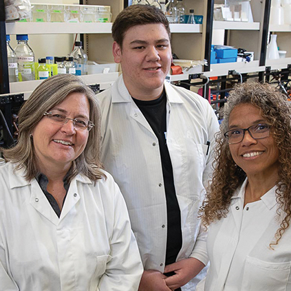 UCLA student José Gonzalez, who does autism research, poses with coworkers in the lab.