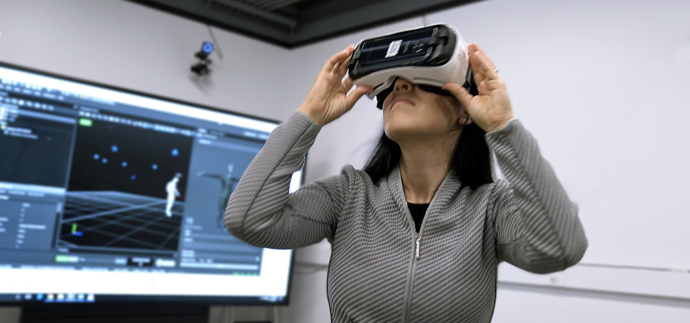 UCLA neuroscientist Nanthai Suthana models virtual reality glasses used in her research.