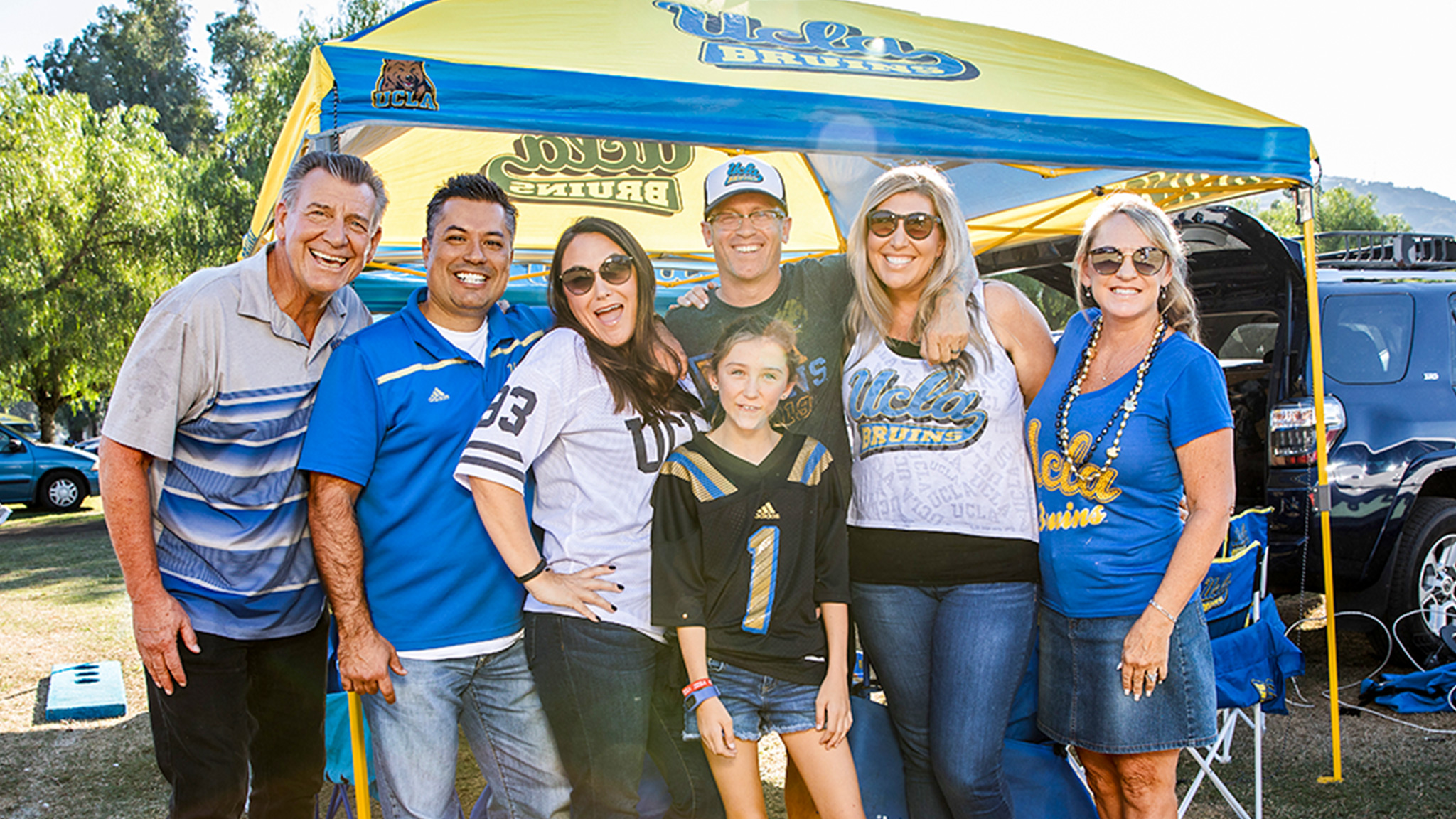 A family tailgates before seeing UCLA Football at the Rose Bowl during Bruin Family Weekend.