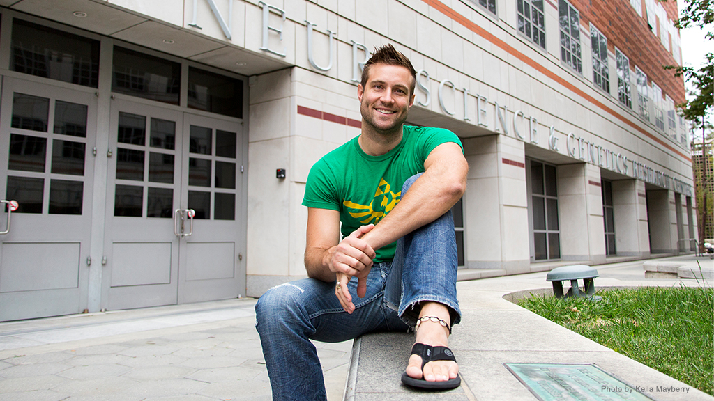 Former neuroscience grad student Don Vaughn smiles outside a neuroscience research center.