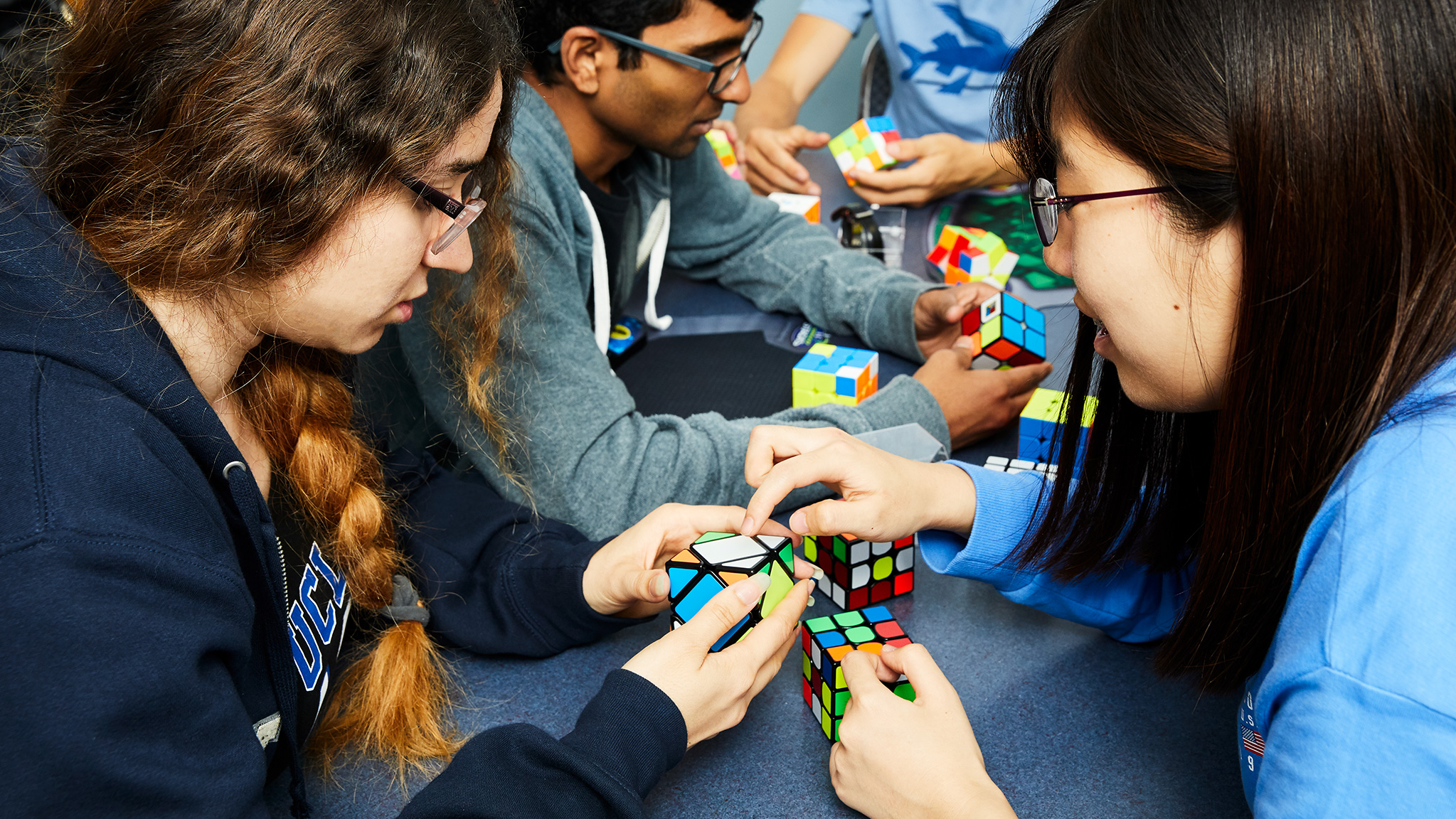 Cubing Club at UCLA members pose together with their Rubik's Cubes.