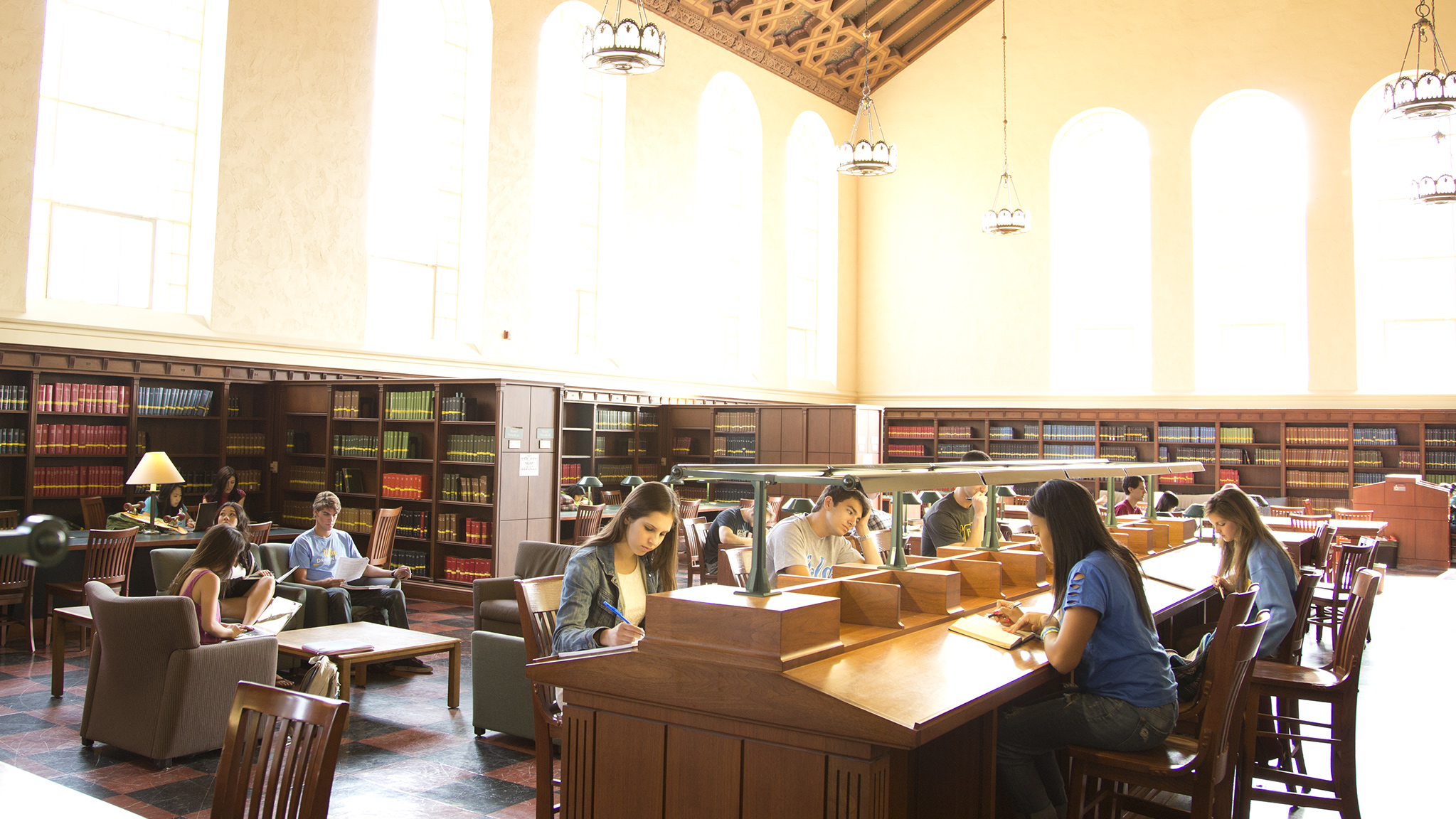 Students study in Powell Library, the main undergraduate library on campus.