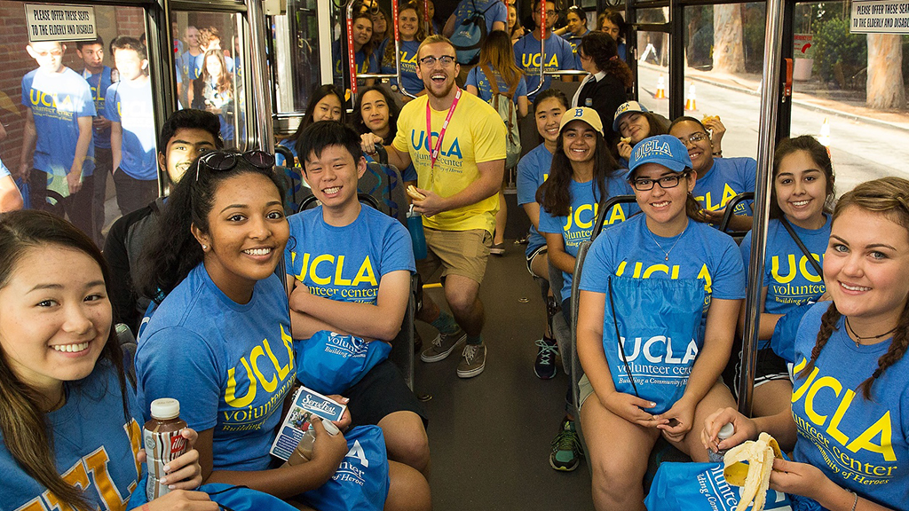 Volunteer Day participants ride a bus together en route to a charitable event.