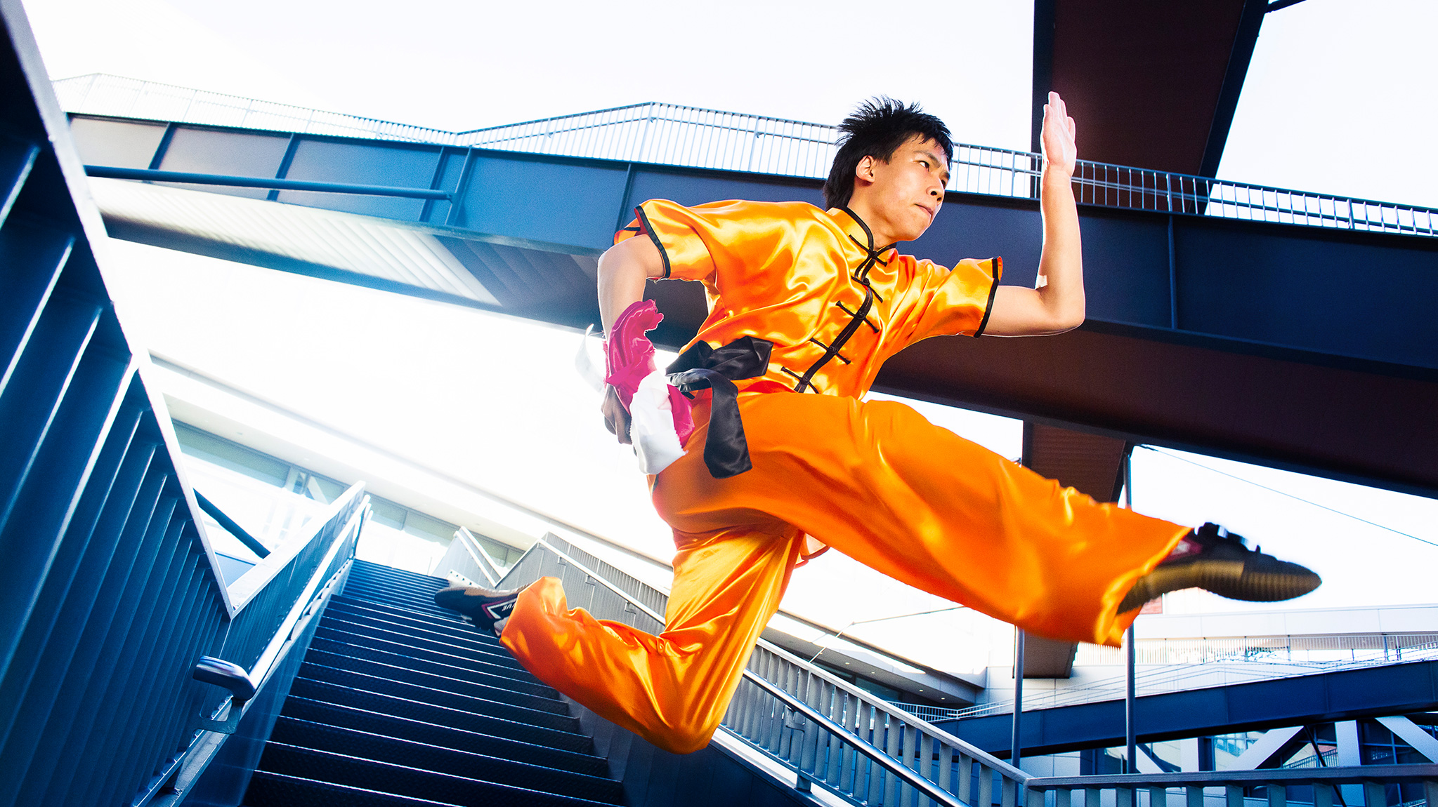 A Wushu team member demonstrates a jumping move.